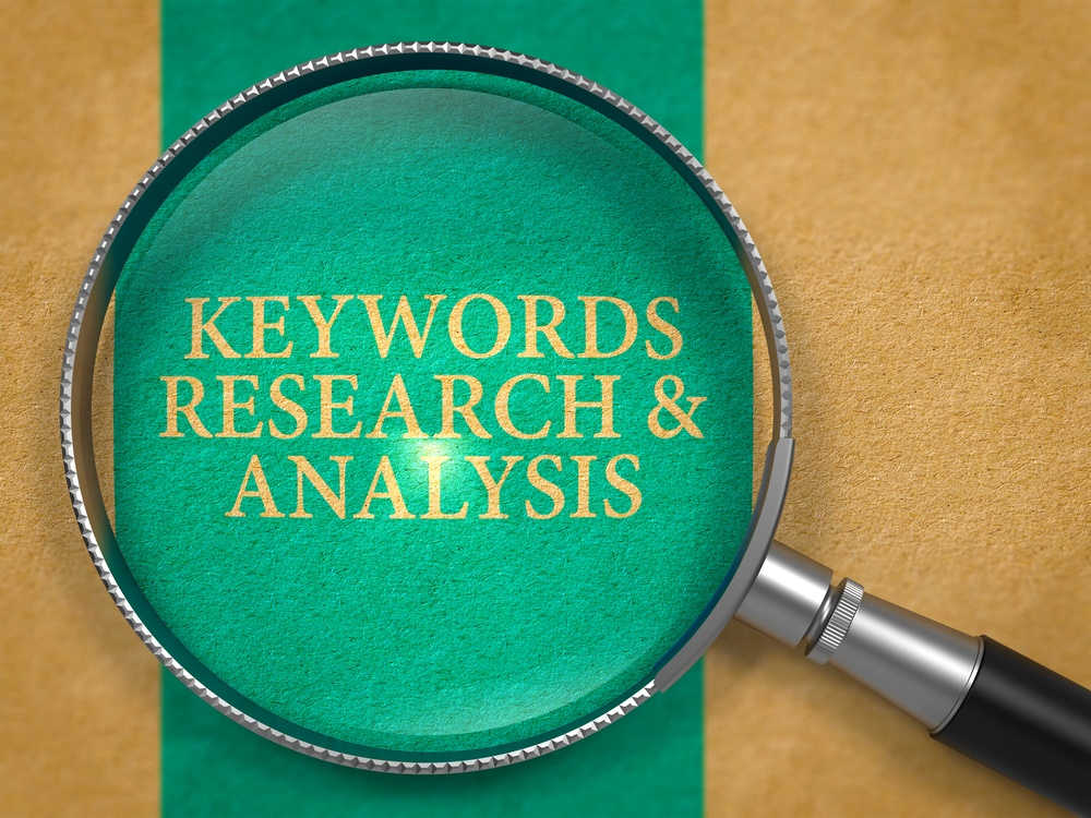 Keywords Research and Analysis through Loupe on Old Paper with Blue Vertical Line Background..jpeg