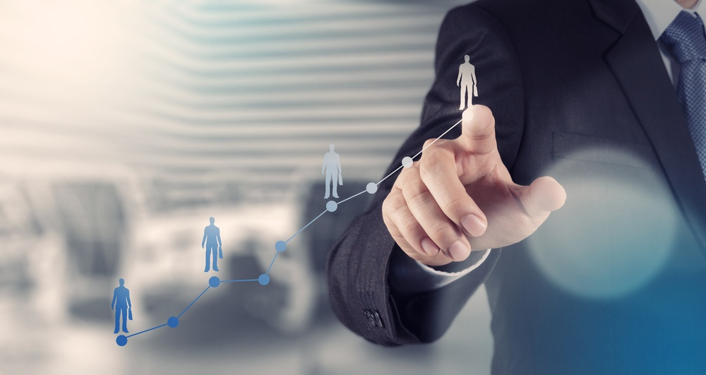 businessman hand working with new modern computer and business strategy as concept.jpeg